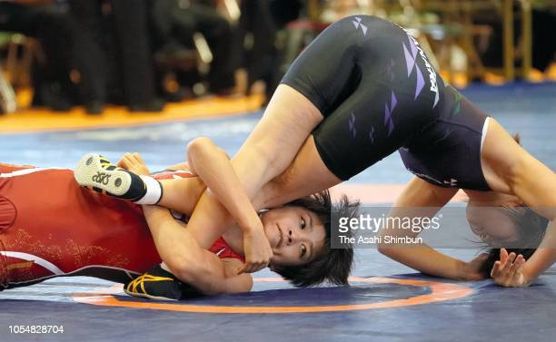 Kaori Icho and Ayako Shimanaka compete in the 57kg first round during the Wrestling All Japan Women's Open Championship at Mishima City Gymnasium on...