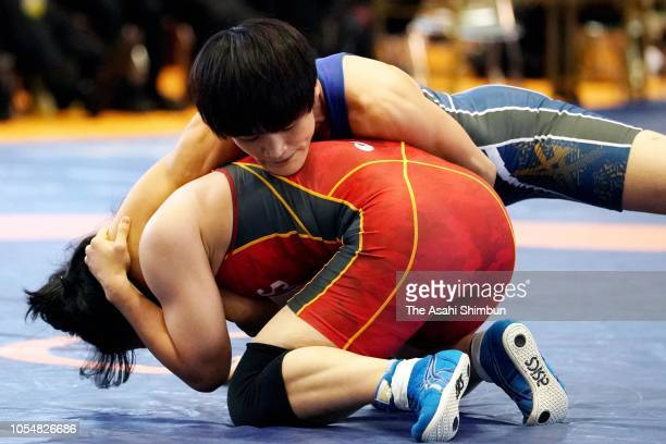 Kaori Icho and Fusano Mochizuki compete in the 57kg final during the Wrestling All Japan Women's Open Championship at Mishima City Gymnasium on...