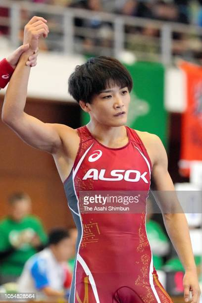 Kaori Icho celebrates winning against Ayako Shimanaka in the 57kg first round during the Wrestling All Japan Women's Open Championship at Mishima...