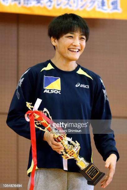 Kaori Icho celebrates winning the 57kg event with the trophy during the Wrestling All Japan Women's Open Championship at Mishima City Gymnasium on...