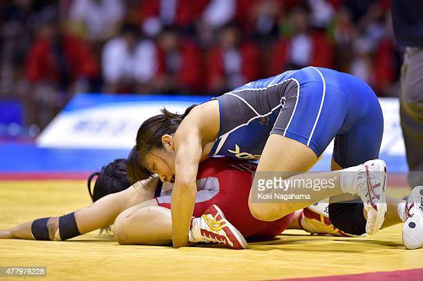 Kaori Icho competes in the Women's 58kg free style final match against Mikako Higuchi during All Japan Wrestling Championships at Yoyogi National...