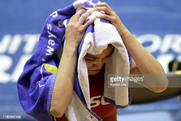 Kaori Icho covers her face with a towel as she reacts after losing the Women's 57kg playoff match against Risako Kawai during the Wrestling World...
