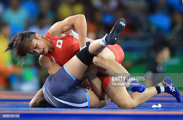 Kaori Icho of Japan and Marwa Amri of Tunisia compete in the Women's 58kg third round on Day 12 of the Rio 2016 Olympic Games at Caioca Arena 2 on...