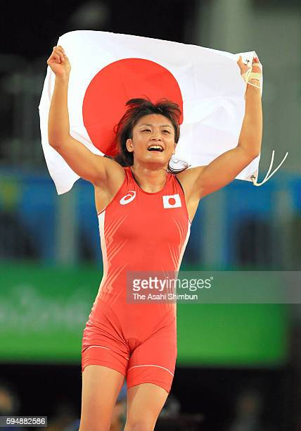 Kaori Icho of Japan celebrates winning the gold medal after the Women's 58kg gold medal contest against Valeriia Koblova Zholobova of Russia on Day...