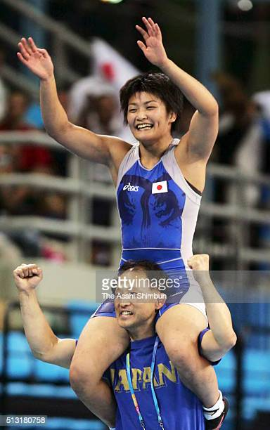 Kaori Icho of Japan celebrates winning the gold with her coach Kazuhito Sakae after the Wrestling Women's 63kg final at the Ano Liossia Olympic Hall...