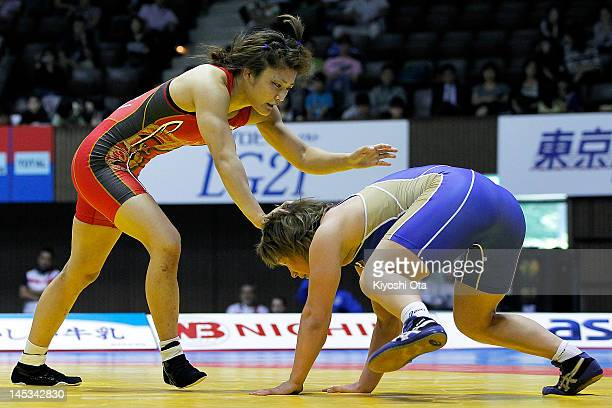 Kaori Icho of Japan competes against Liubov Volosova of Russia in the 63kg division of the final match between Japan and Russia during day two of the...