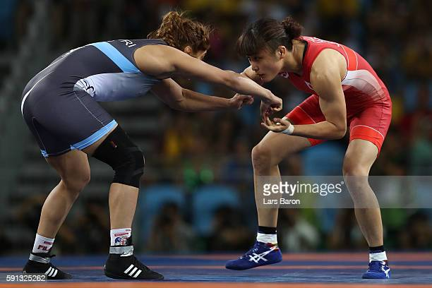 Kaori Icho of Japan competes against Marwa Amri of Tunisia during a Women's Freestyle 58kg 1/8 Final bout on Day 12 of the Rio 2016 Olympic Games at...
