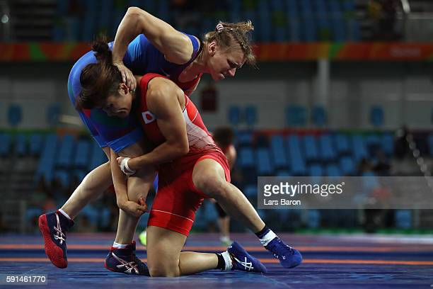 Kaori Icho of Japan competes against Yuliya Ratkevich of Azerbaijan during a Women's Freestyle 58kg Semifinal bout on Day 12 of the Rio 2016 Olympic...
