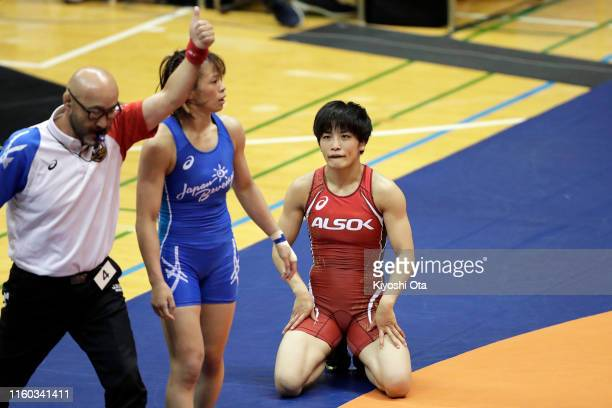 Kaori Icho reacts while competing against Risako Kawai in the Women's 57kg playoff match during the Wrestling World Championships Japan Playoffs at...
