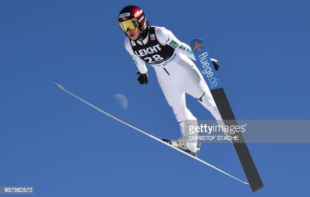 Kaori Iwabuchi from Japan competes during her trial jump of the ski jumping World Cup Ladies competition in Oberstdorf southern Germany on March 24...