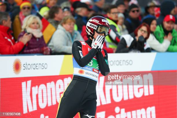 Kaori Iwabuchi of Japan reacts after her jump during the second round of the HS109 women's ski jumping Competition of the FIS Nordic World Ski...