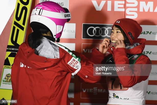 Kaori Iwabuchi of Japan shares a laugh with team mate Yuka Seto during day three of the FIS Ski Jumping Women's World cup Zao at Kuraray Zao Schanze...