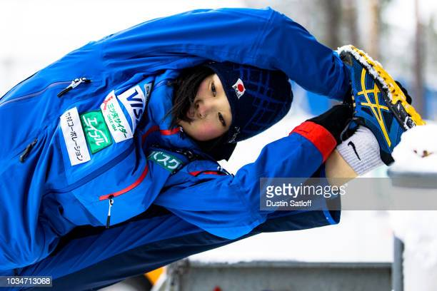Kaori Iwabuchi of Japan stretches before the start of the Women's Ski Jumping HS100 qualification rounds during the FIS Nordic World Ski...
