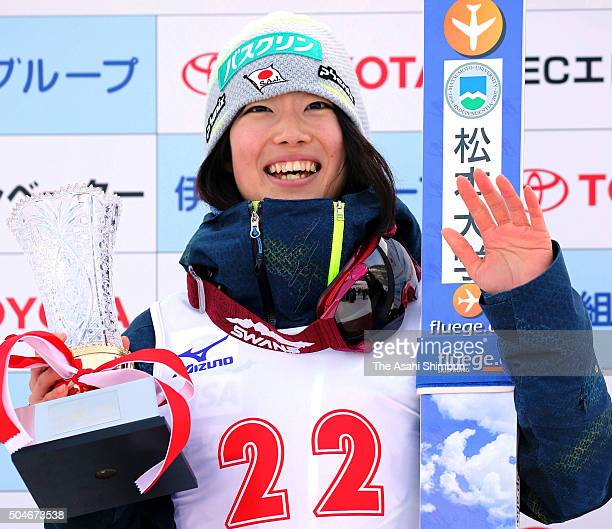 Kaori Iwabuchi poses for photographs on the podium after winning the Women's event of the TVh Cup at Okurayama Jump Stadium on January 10, 2016 in...