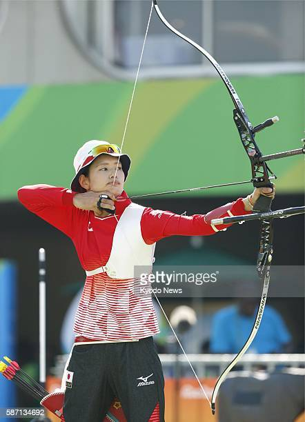 Kaori Kawanaka of Japan aims at the target in the first round of the women's archery team tournament at the Rio de Janeiro Olympics on Aug 7 2016...