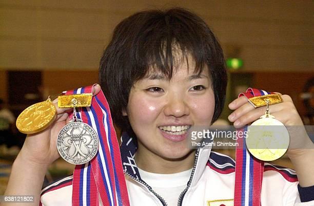 Kaori Niyanagi of Japan celebrates winning 'snatch' and 'total' in the Women's 48kg during the Weightlifting Asian Championships at Nagai Stadium on...