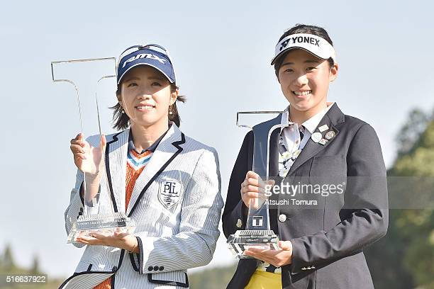 Kaori Oe of Japan and Suzuka Yamaguchi of Japan pose with the trophy after winning the T-Point Ladies Golf Tournament at the Wakagi Golf Club on...