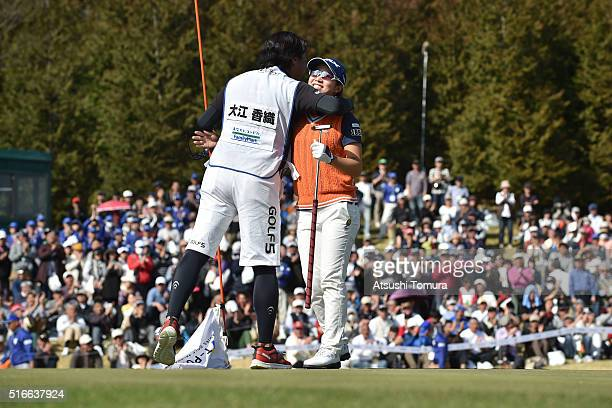 Kaori Oe of Japan celebrates with her caddie after winning the T-Point Ladies Golf Tournament at the Wakagi Golf Club on March 20, 2016 in Takeo,...