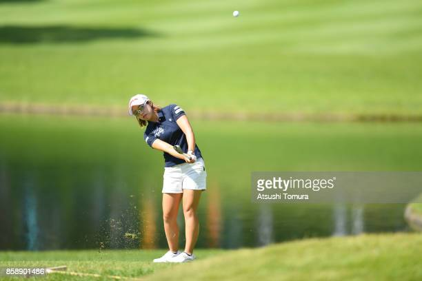 Kaori Oe of Japan chips onto the 8th green during the final round of Stanley Ladies Golf Tournament at the Tomei Country Club on October 8, 2017 in...