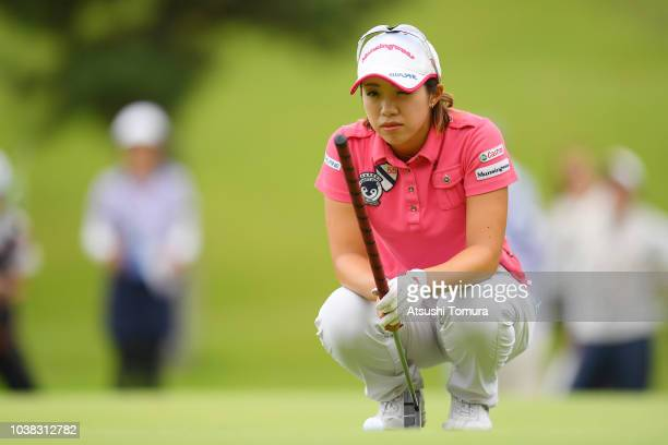 Kaori Oe of Japan lines up her putt on the 17th hole during the final round of the Miyagi TV Cup Dunlop Ladies Open at Rifu Golf Club on September 23...