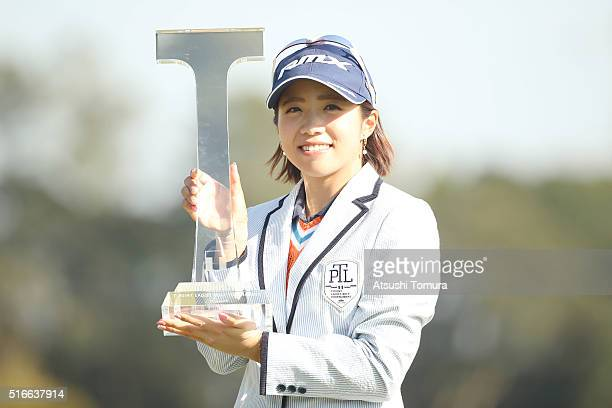 Kaori Oe of Japan poses with the trophy after winning the T-Point Ladies Golf Tournament at the Wakagi Golf Club on March 20, 2016 in Takeo, Japan.