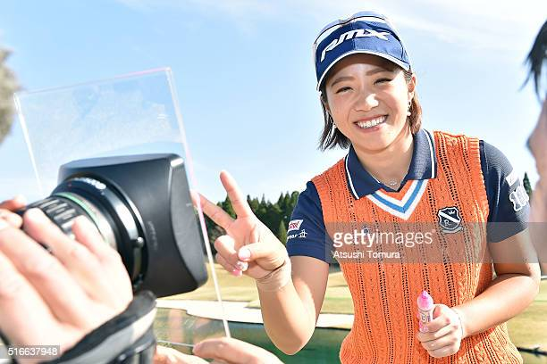 Kaori Oe of Japan signs an autograph on the TV camera after winning the T-Point Ladies Golf Tournament at the Wakagi Golf Club on March 20, 2016 in...