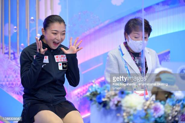 Kaori Sakamoto of Japan reacts in the kiss and cry after the Ladies Free Skating during day 2 of the ISU Grand Prix of Figure Skating NHK Trophy at...