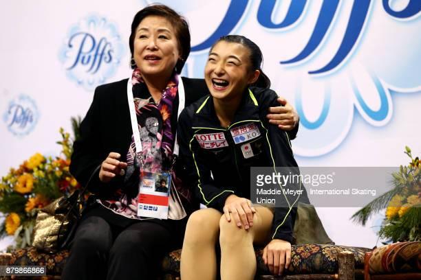Kaori Sakamoto of Japan reacts with her coach Sonoko Nakano to her score in the Ladies Free Dance program on Day 3 of the ISU Grand Prix of Figure...
