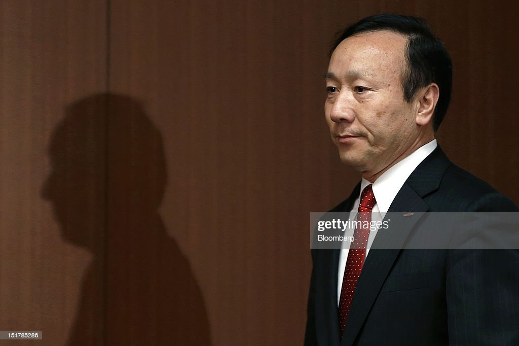Kaoru Kato, president and chief executive officer of NTT DoCoMo Inc., arrives for a news conference in Tokyo, Japan, on Friday, Oct. 26, 2012. NTT DoCoMo, Japan's largest mobile-phone company, cut its annual profit forecast 9 percent after competitors lured customers with Apple Inc.'s iPhone 5. Photographer: Kiyoshi Ota/Bloomberg via Getty Images