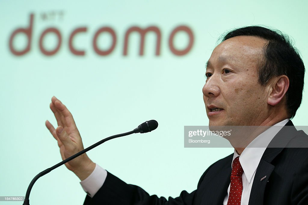 Kaoru Kato, president and chief executive officer of NTT DoCoMo Inc., gestures as he speaks during a news conference in Tokyo, Japan, on Friday, Oct. 26, 2012. NTT DoCoMo, Japan's largest mobile-phone company, cut its annual profit forecast 9 percent after competitors lured customers with Apple Inc.'s iPhone 5. Photographer: Kiyoshi Ota/Bloomberg via Getty Images