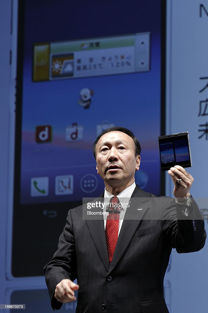 Kaoru Kato, president and chief executive officer of NTT DoCoMo Inc., introduces the company's Medias W N-05E smartphone, manufactured by NEC Casio Mobile Communications Ltd., during a news conference in Tokyo, Japan, on Tuesday, Jan. 22, 2013. NTT DoCoMo, Japan's biggest mobile-phone company, released their latest tablet and smartphone series today. Photographer: Kiyoshi Ota/Bloomberg via Getty Images