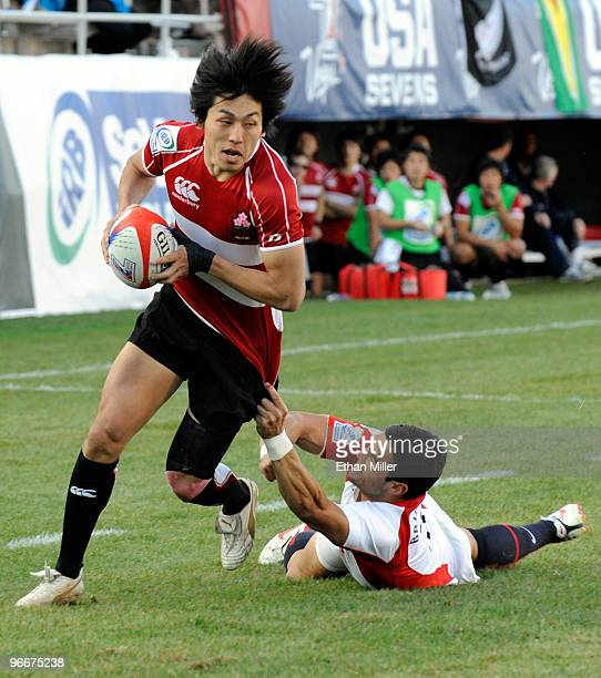 Kaoru Matsushita of Japan gets away from Chris Brightwell of England en route to scoring a try during the IRB Sevens World Series at Sam Boyd Stadium...