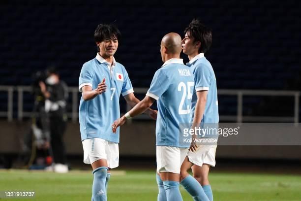 Kaoru Mitoma, Daizen Maeda and Ao Tanaka of Japan celebrate their 6-0 victory in the U-24 international friendly match between Japan and Ghana at the...