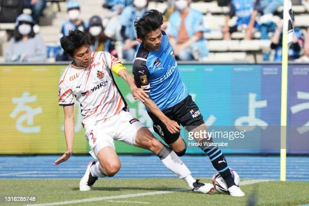 Kaoru Mitoma of Kawasaki Frontale and Yuichi Maruyama of Nagoya Grampus compete for the ball during the J.League Meiji Yasuda J1 match between...