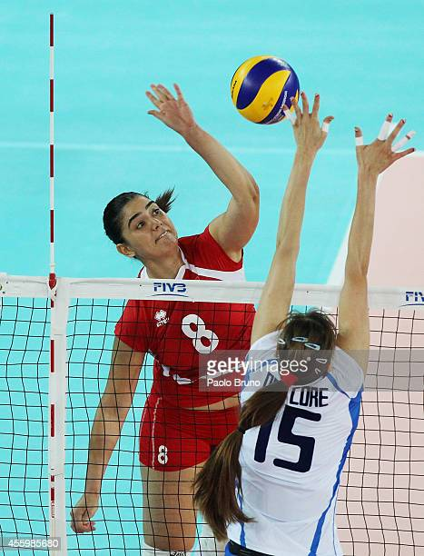 Kaouthar Jemaii of Tunisia spikes the ball as Antonella Del Core of Italy blocks during the FIVB Women's World Championship pool A match between...