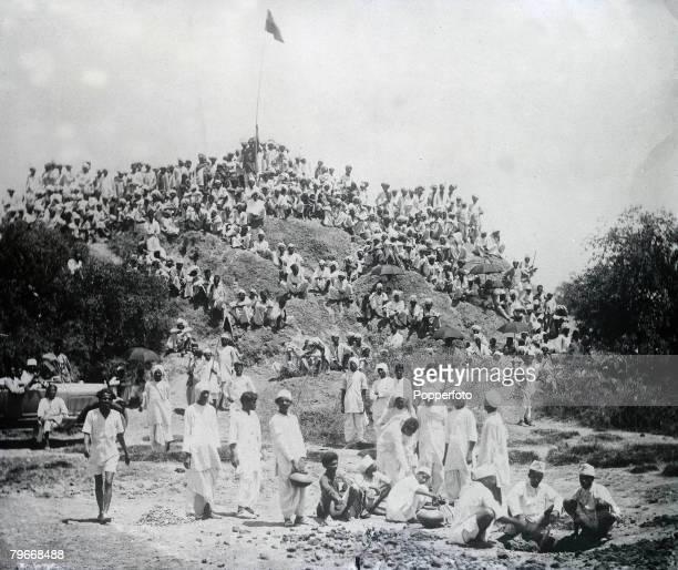 Kapadwamj India 6th May Gandhi volunteers in camp at Kapadwanj watching members of their band making salt following the civil disobedience riots and...
