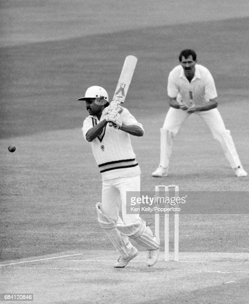 Kapil Dev batting for India during the 3rd Test match between England and India at Edgbaston Birmingham 5th July 1986 The England fielder is Graham...