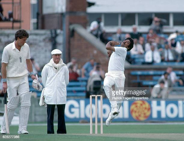 Kapil Dev bowling for India during the 2nd Test match between England and India at Old Trafford Manchester 26th June 1982 The batsman for England is...