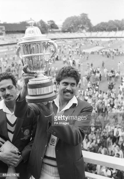 Kapil Dev captain of India's Prudential World Cup cricket team holds the trophy aloft after beating the West Indies