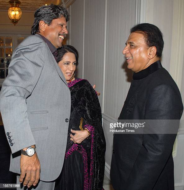 Kapil Dev, Chhaya Momaya and Sunil Gavaskar pose for the cameras attend an event organised by Ulysse Nardin to honour Sunil Gavaskar at Taj Mahal...