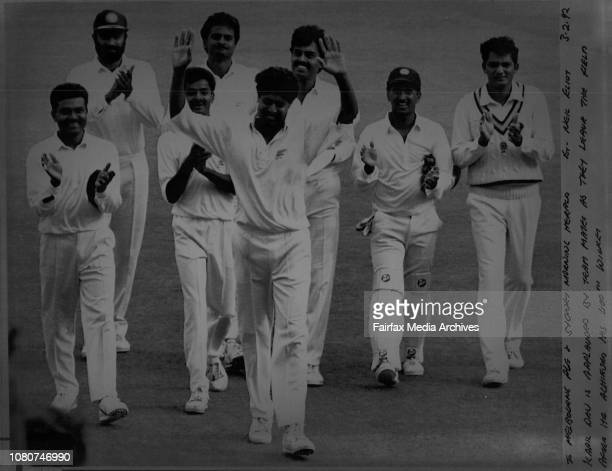 Kapil Dev is applauded by team mates as they leave the held after he achieved his 400th WicketIndian fast bowler Kapil Dev is applauded after...