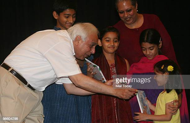 Kapil Sibal interacts with the kids at the launch of the book We The Children Of India The Preamble To Our Constitution by Author Leila Seth in New...