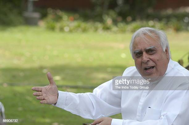 Kapil Sibal Union Cabinet Minister of Science and Technology and Ocean Development addressing a press conference about irregularities in foodgrain...