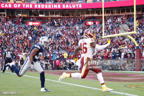 Kapri Bibbs of the Washington Redskins runs into the end zone for a 23yard touchdown after catching a pass in the first quarter of the game against...