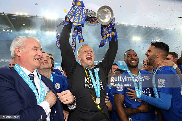 Kapser Schmeichel of Leicester City lifts the Premier League trophy after the Barclays Premier League match between Leicester City and Everton at the...