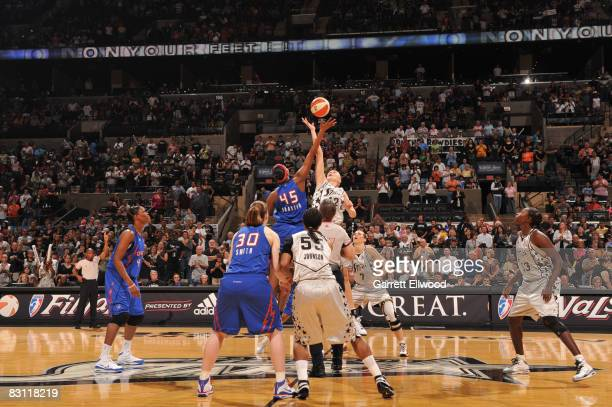 Kara Braxton of the Detroit Shock jumps ball against Ann Wauters of the San Antonio Silver Stars during Game Two of the WNBA Finals on October 3 2008...