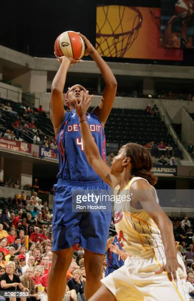 Kara Braxton of the Detroit Shock shoots over Tamika Catchings of the Indiana Fever in Game One of the Eastern Conference Semifinals during the 2008...
