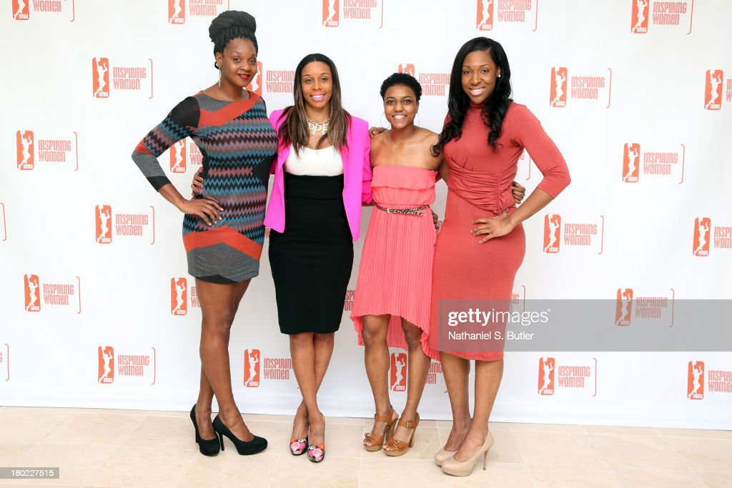 Kara Braxton #45, Plenette Pierson #33, Kamiko Williams #4 and Kelsey Bone #3 of the New York Liberty pose for a picture at the 2013 WNBA Inspiring Women's Luncheon in New York City.