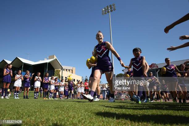 Kara Donnellan of the Dockers leads the team onto the field during the round five AFLW match between the Fremantle Dockers and the Western Bulldogs...