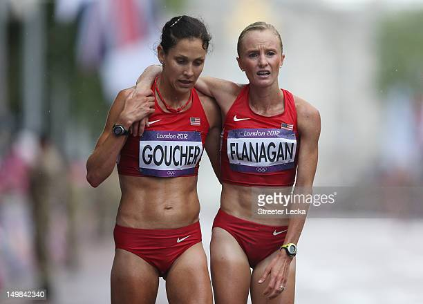 Kara Goucher and Shalane Flanagan of the United States at the finish line after competing during the Women's Marathon on Day 9 of the London 2012...